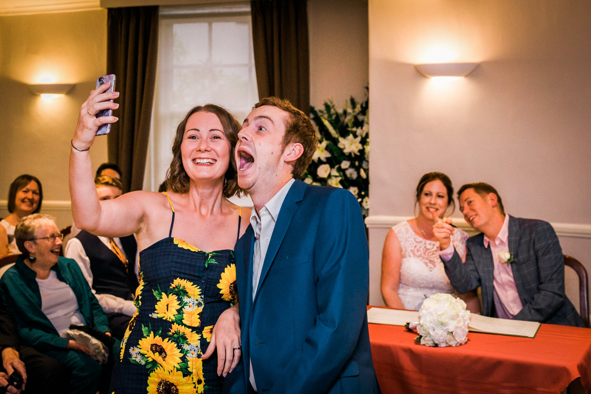 guests photobombing bride and groom during ceremony