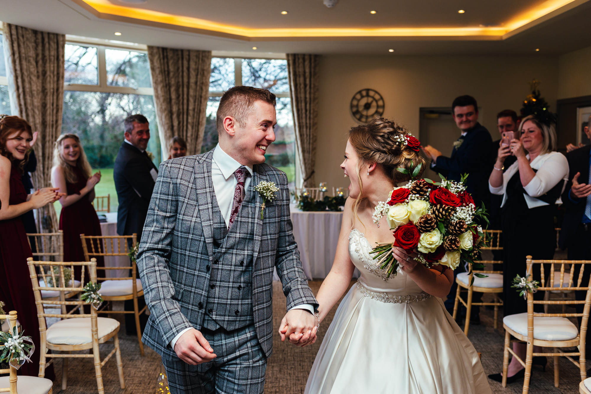 Wedding Photography Nottingham - Bride and groom leaving ceremony laughing together
