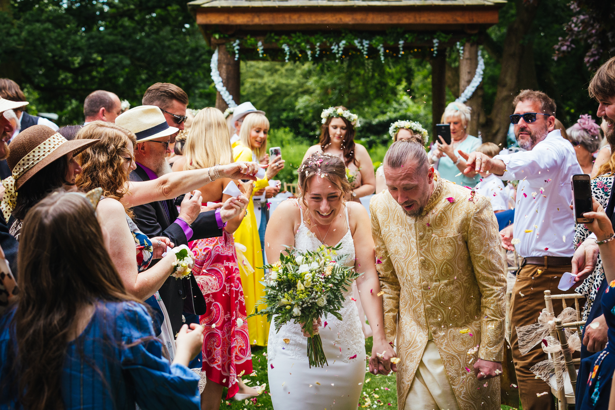 fun wedding photography - couple walking through confetti
