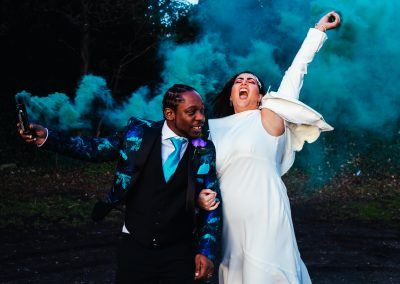 Bride and groom doing smoke bombs during their wedding day