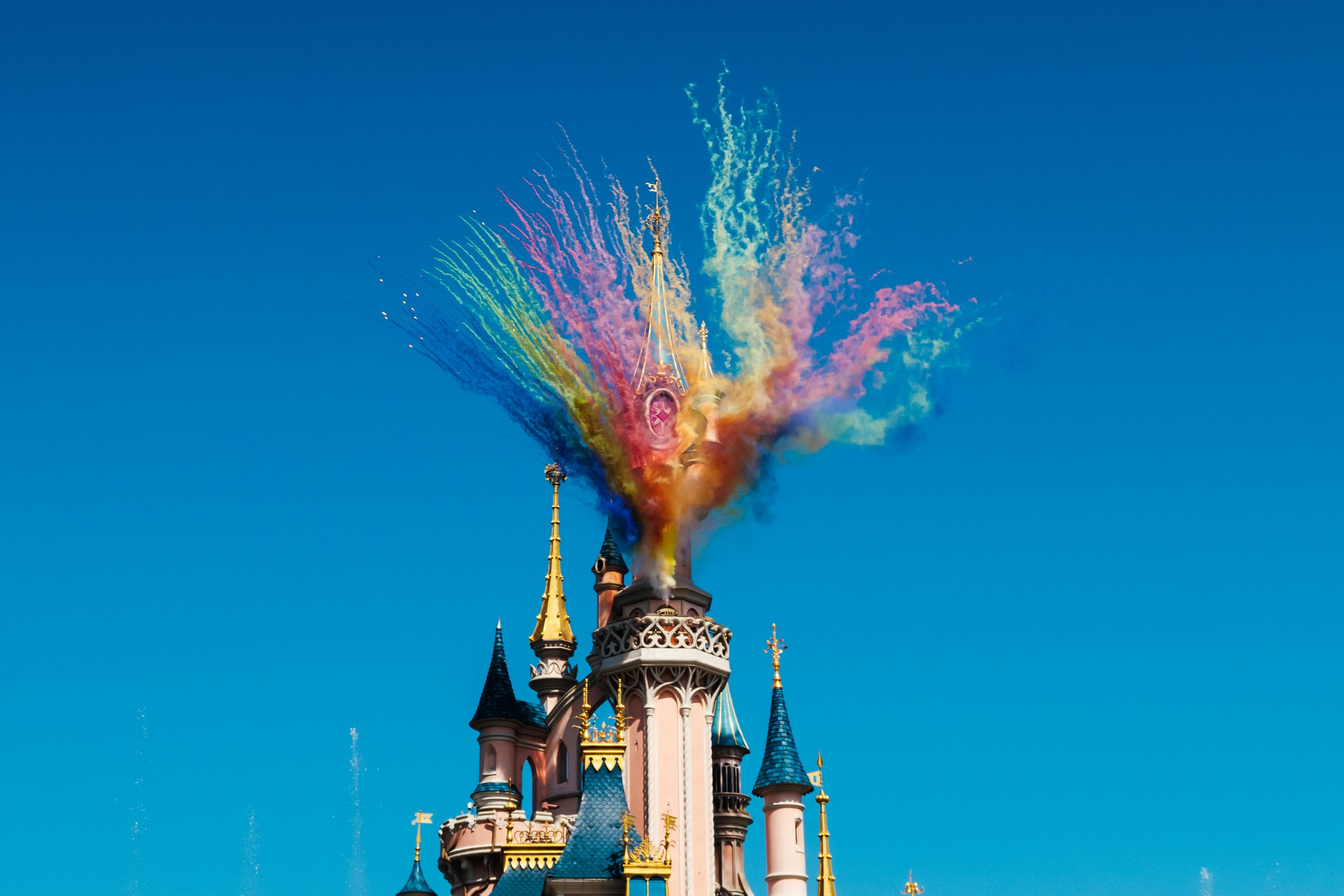 Picture of the castle at Disneyland Paris during the jungle jive show. Coloured smoke coming from the top proper party moment