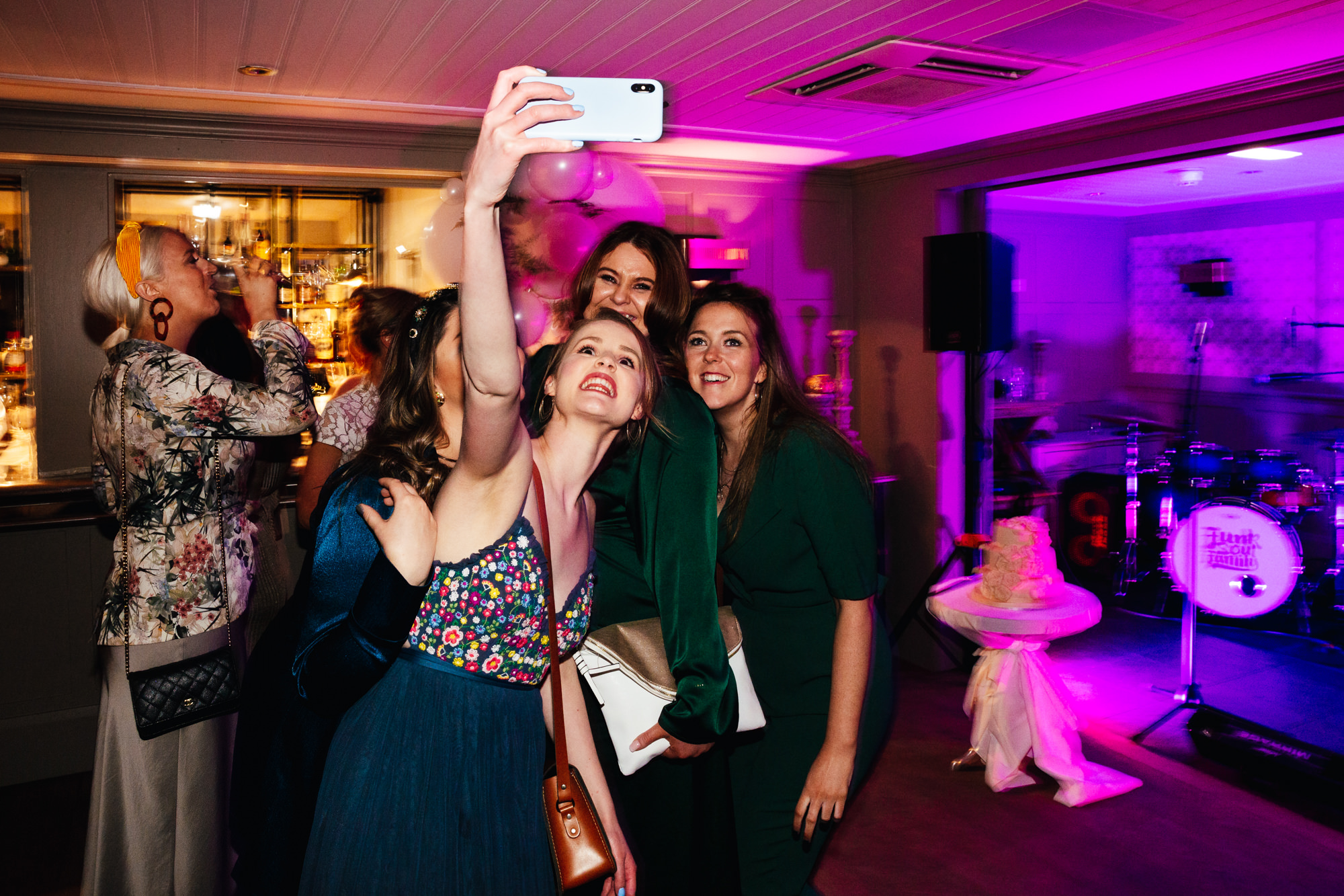 Second Wedding Photographer - Group of friends taking a selfie on the dance floor at wedding