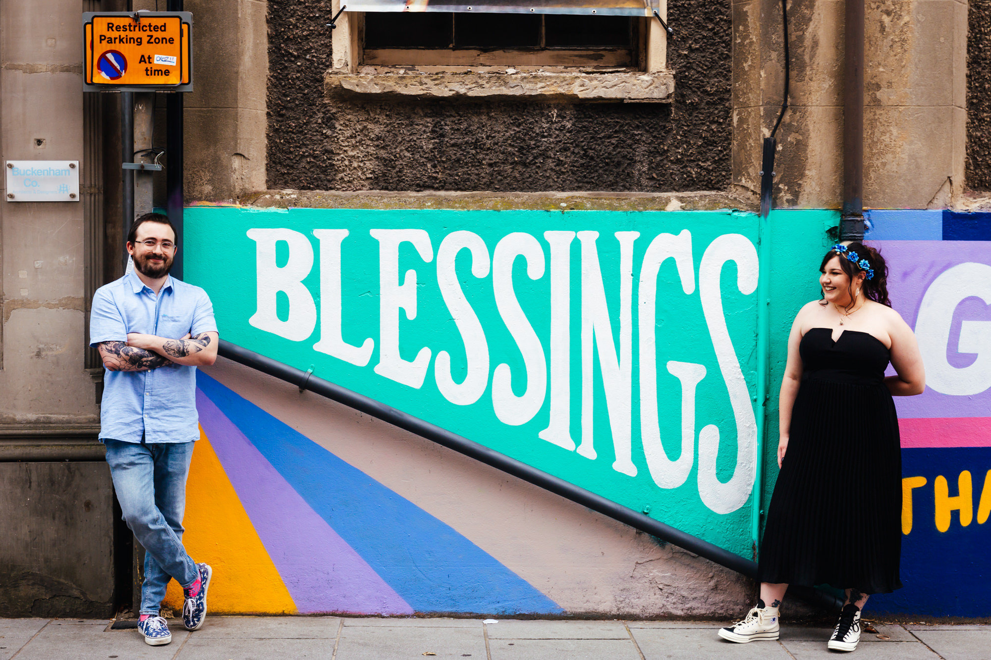 Small Wedding - Couple stood in front of the word blessing