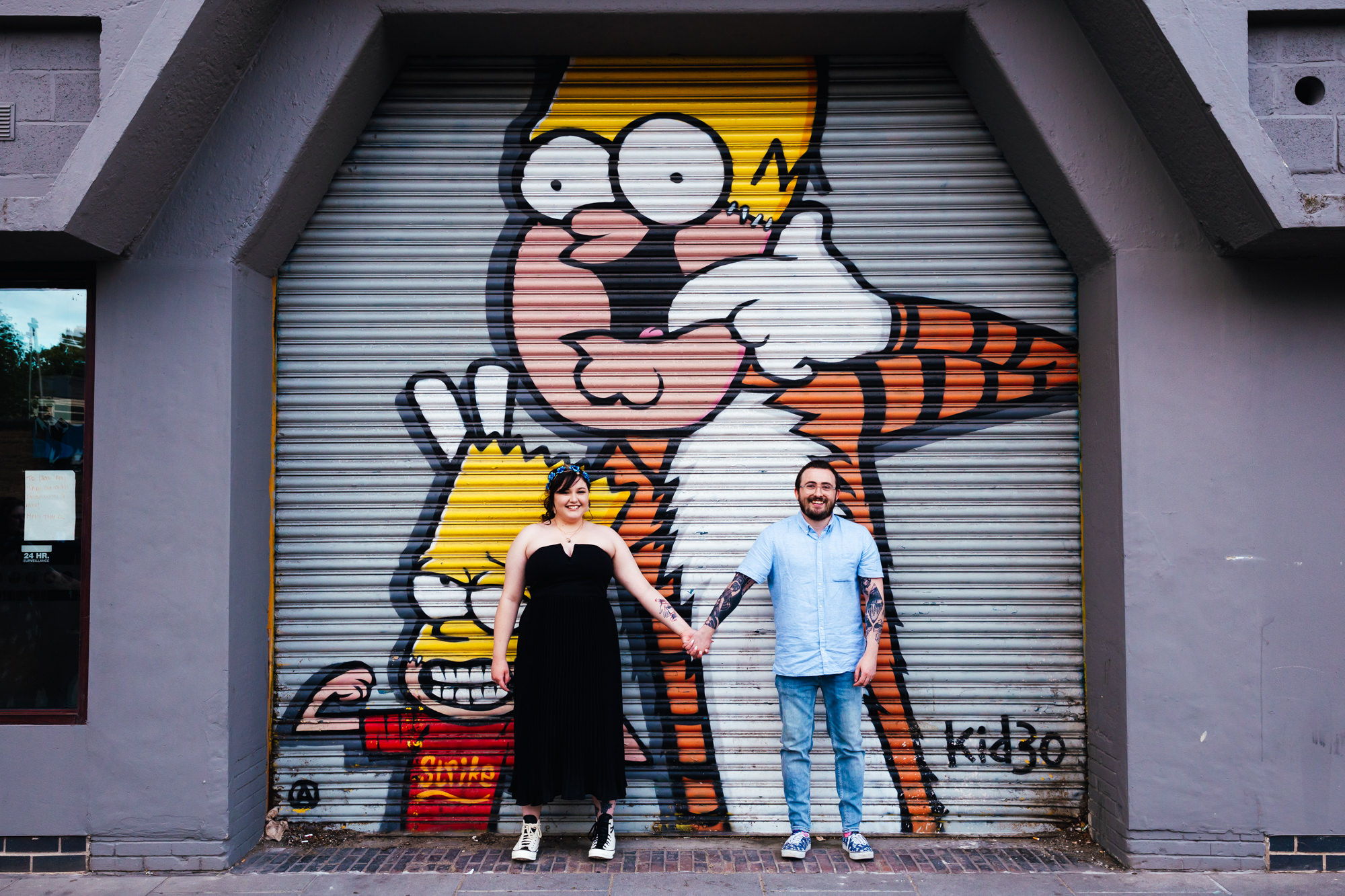 Small Wedding- Couple stood in front of awesome graffiti in Nottingham Town Centre