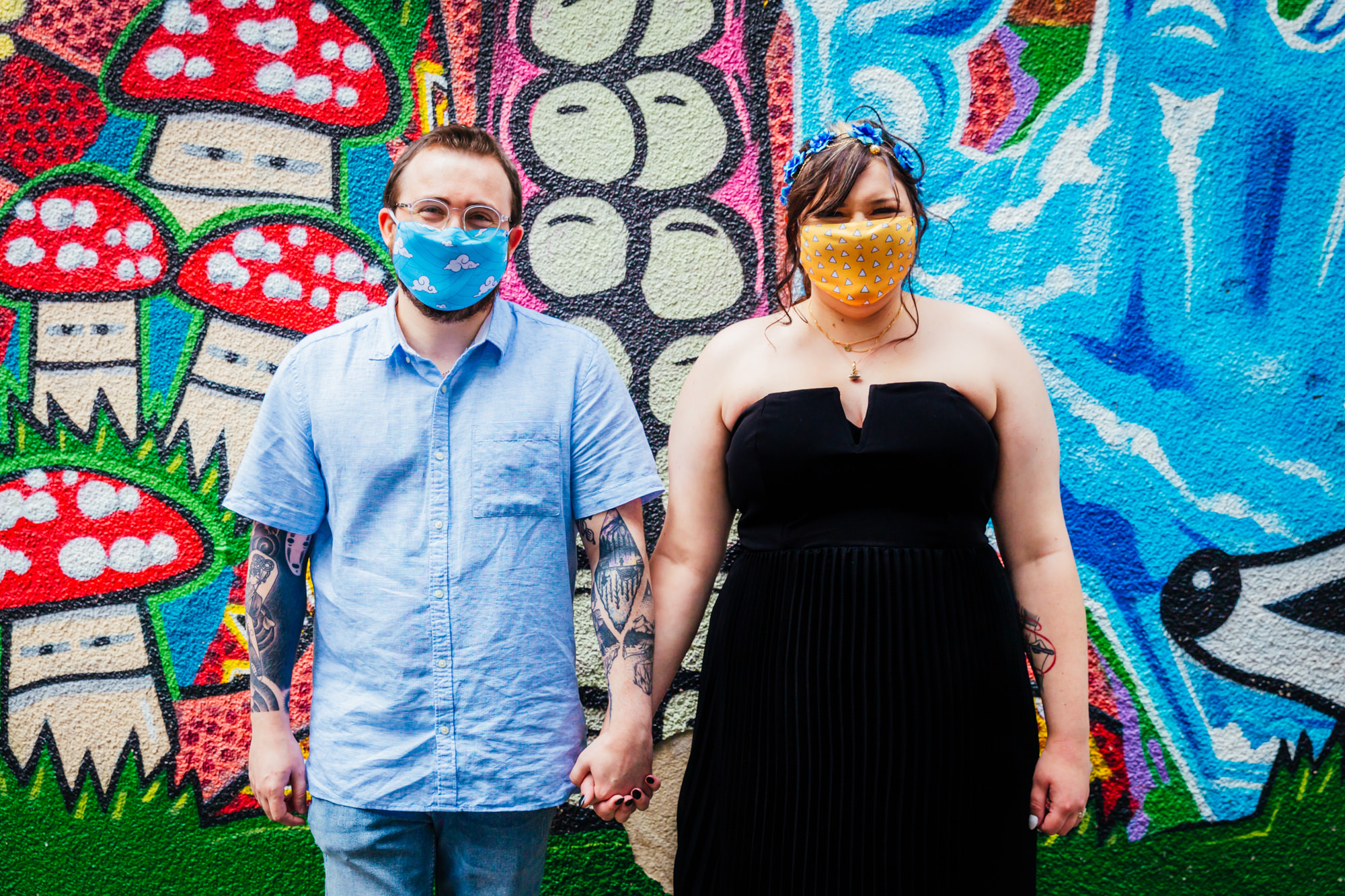 Small Wedding - Couple stood in front of graffiti wall on their wedding day bride wears black