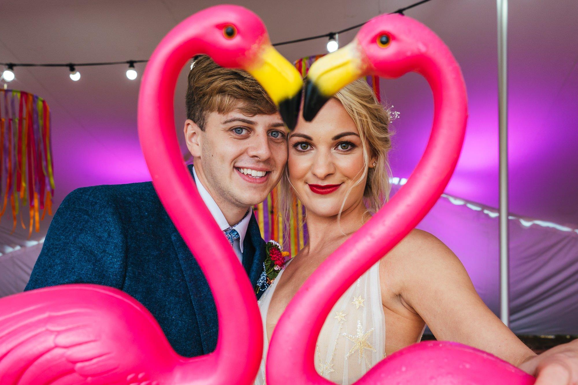Fun wedding photography - Couple posing with flamingos
