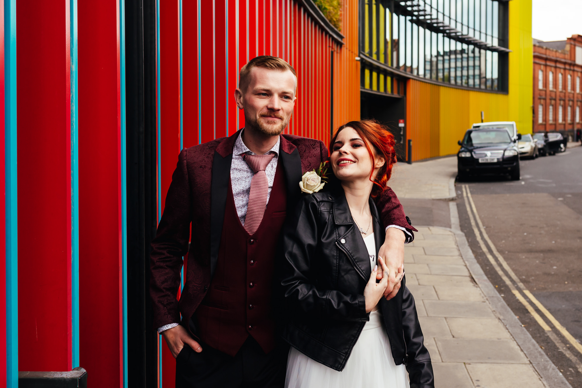 City Micro-Elopement couple stood in front of colourful wall in Camden