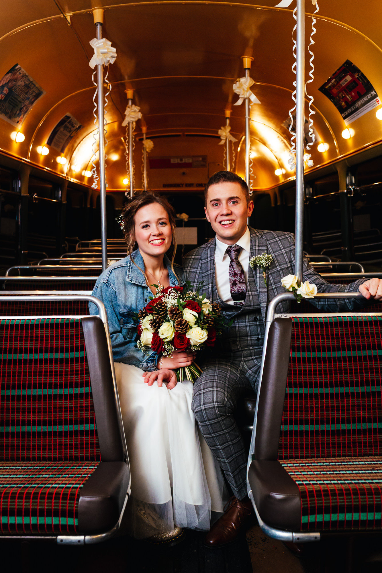 Winter weddings - Couple on vintage bus on there wedding day