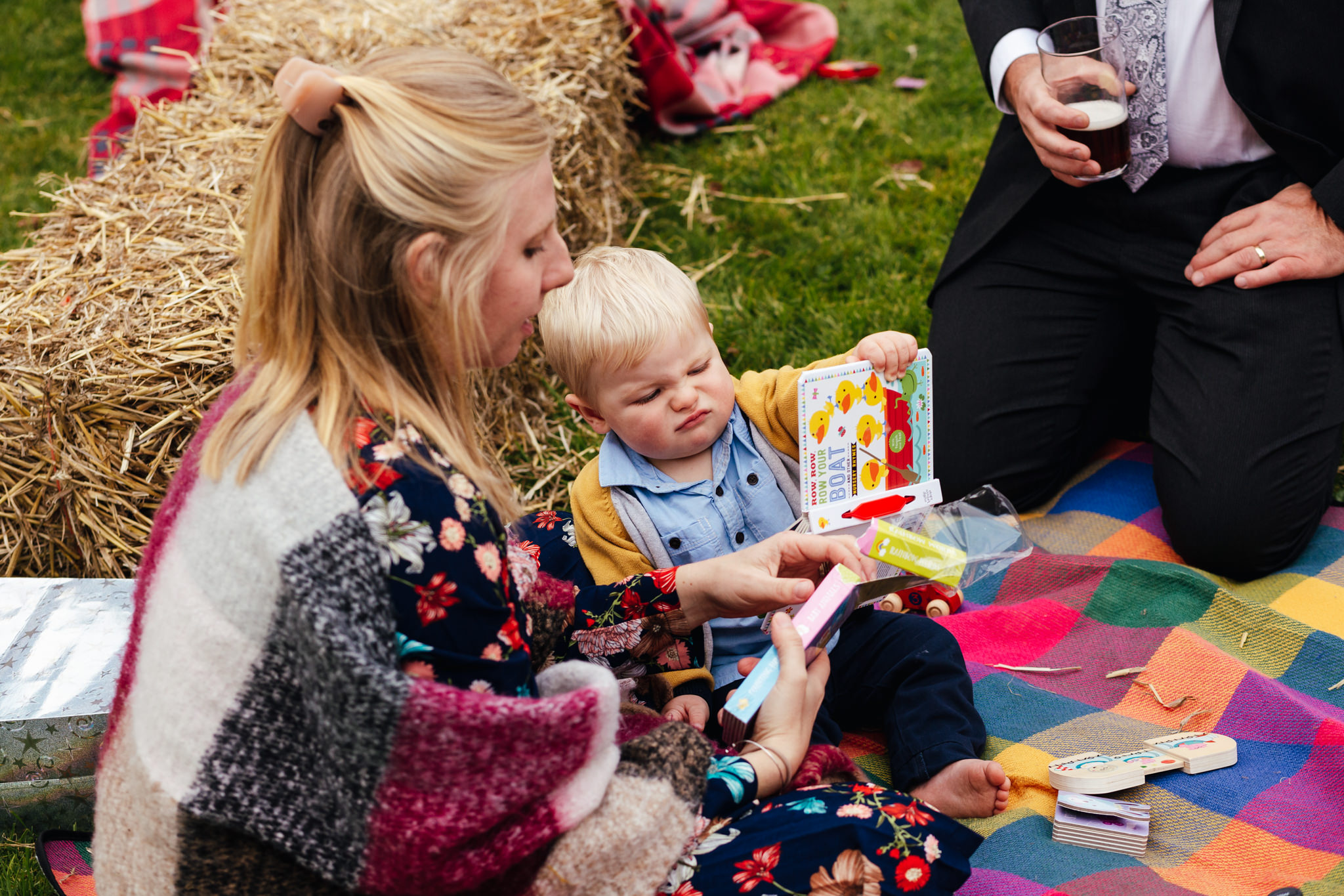 Wedding Photography Nottingham -Baby guest looking really unimpressed with a book