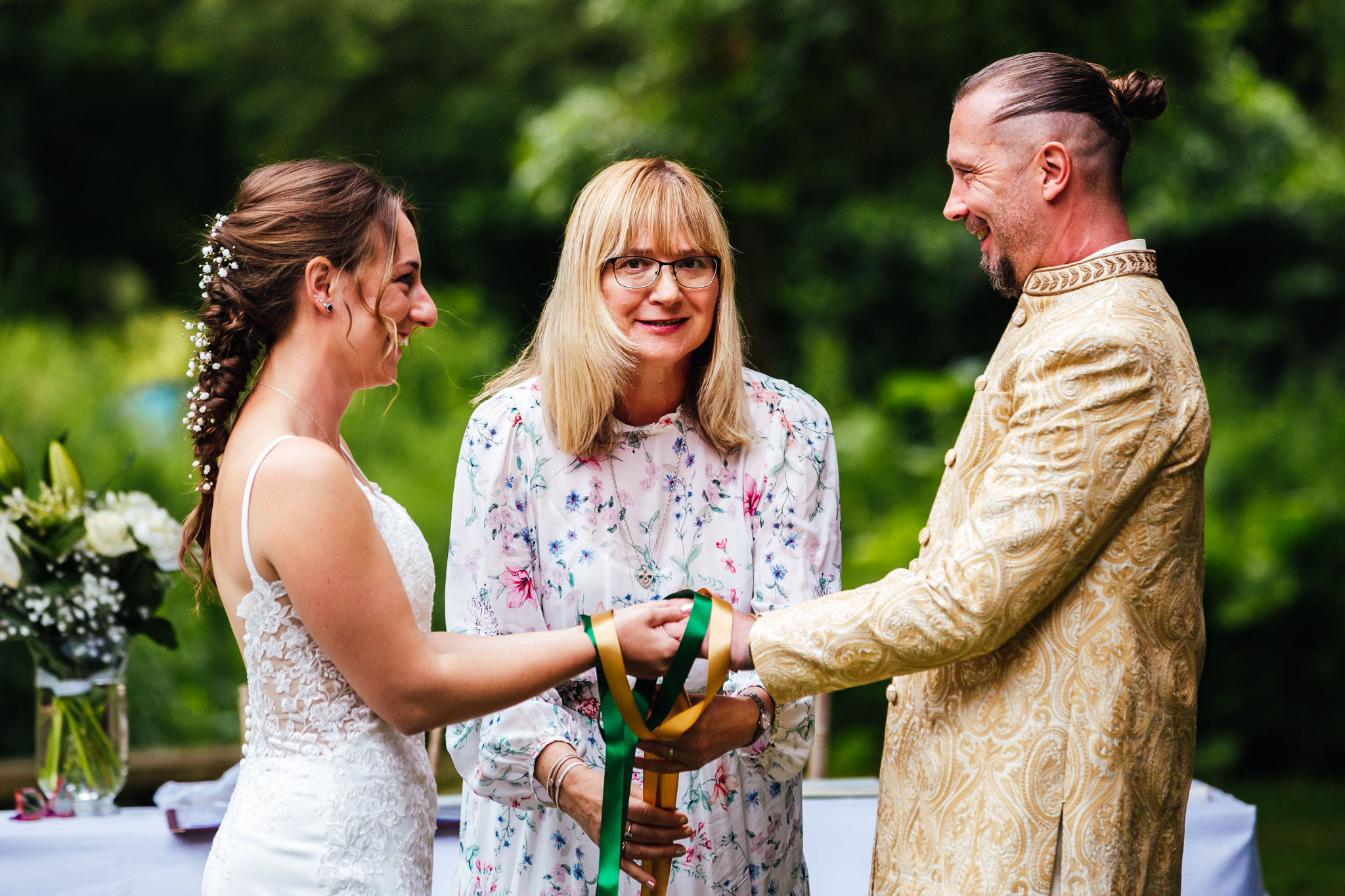 Wedding Celebrants - hand fasting ceremony being carried out at real wedding by celebrant