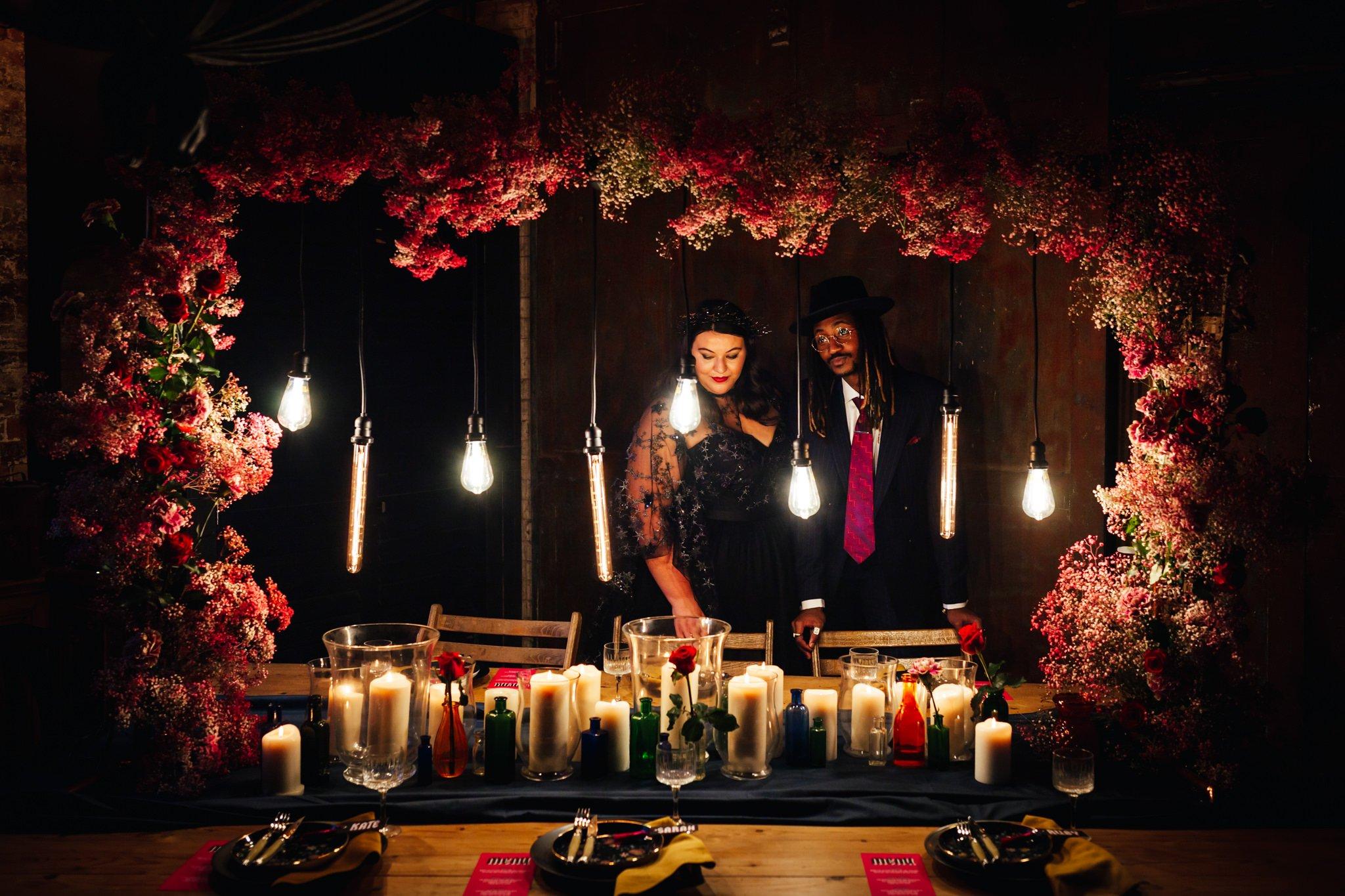 Wedding Venue - Clapham Country Club a dark room dressed with a stunning flower arrangement