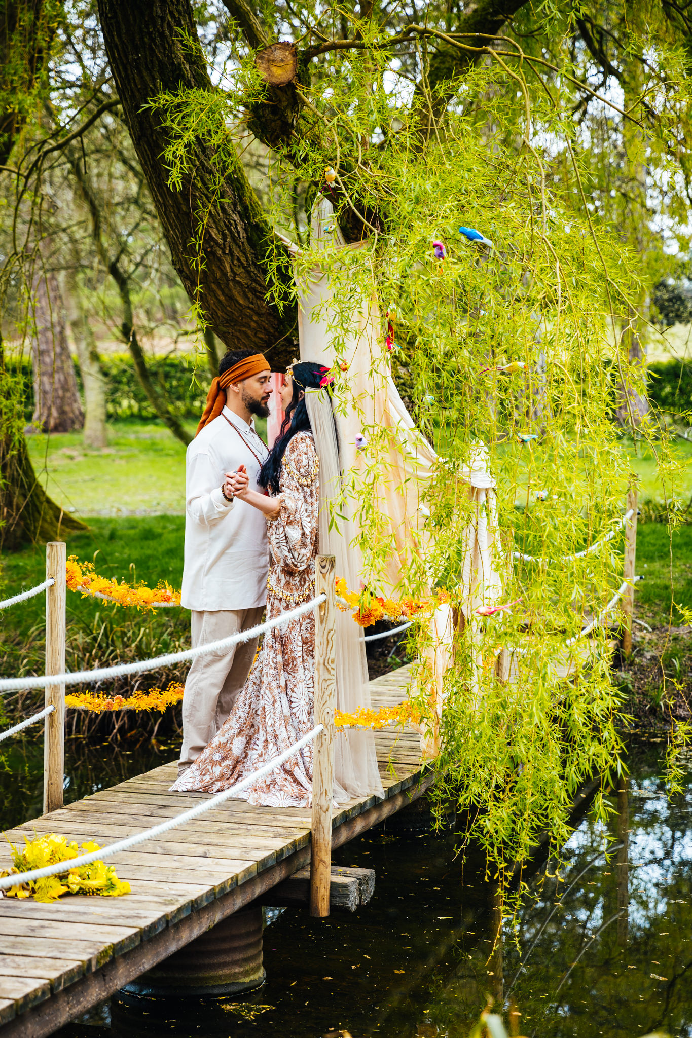 Happy Valley Norfolk - Couple stood on bride to island surrounded by trees