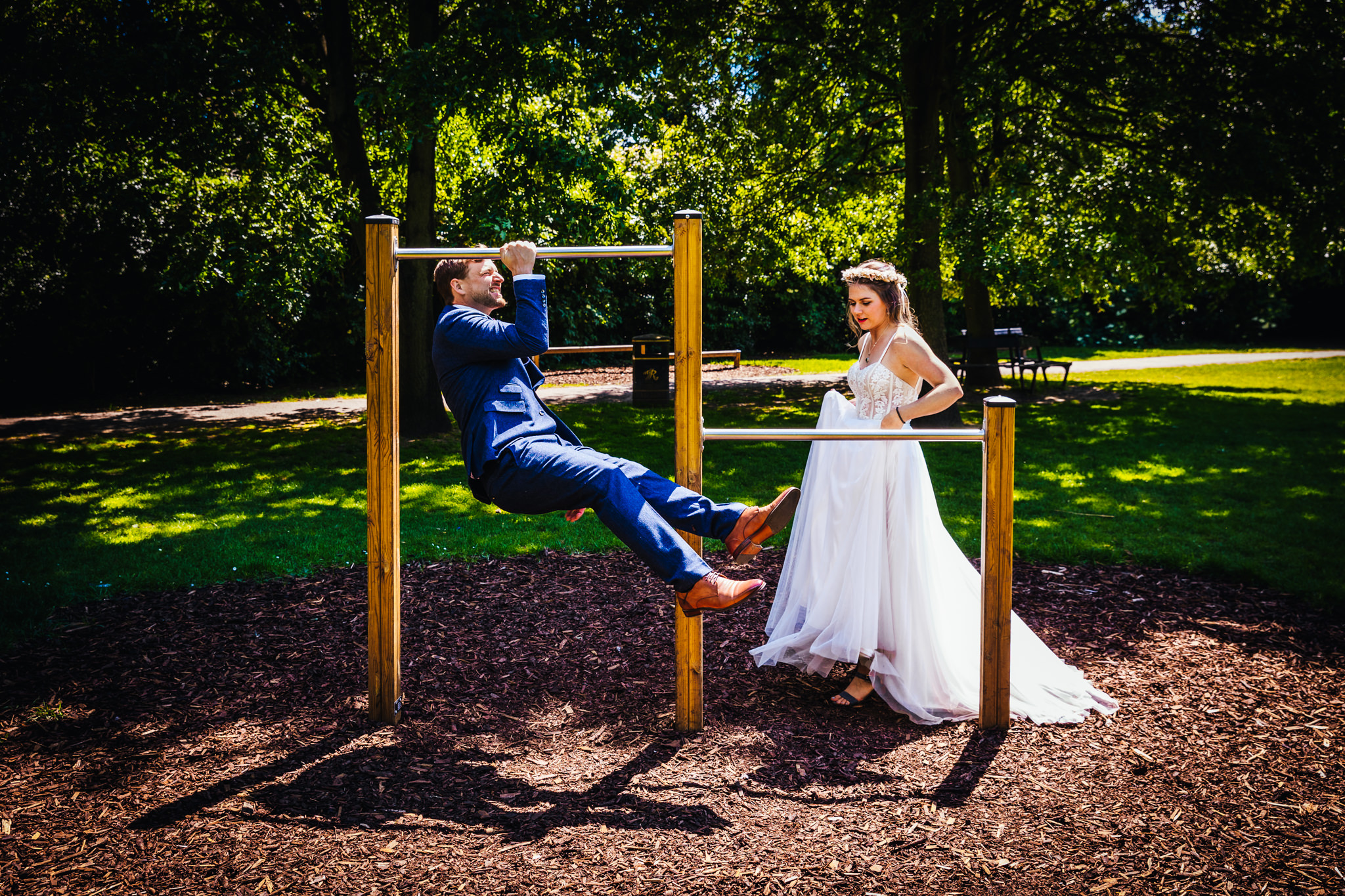 Wedding Photography Nottingham - Couple playing on the park during portraits