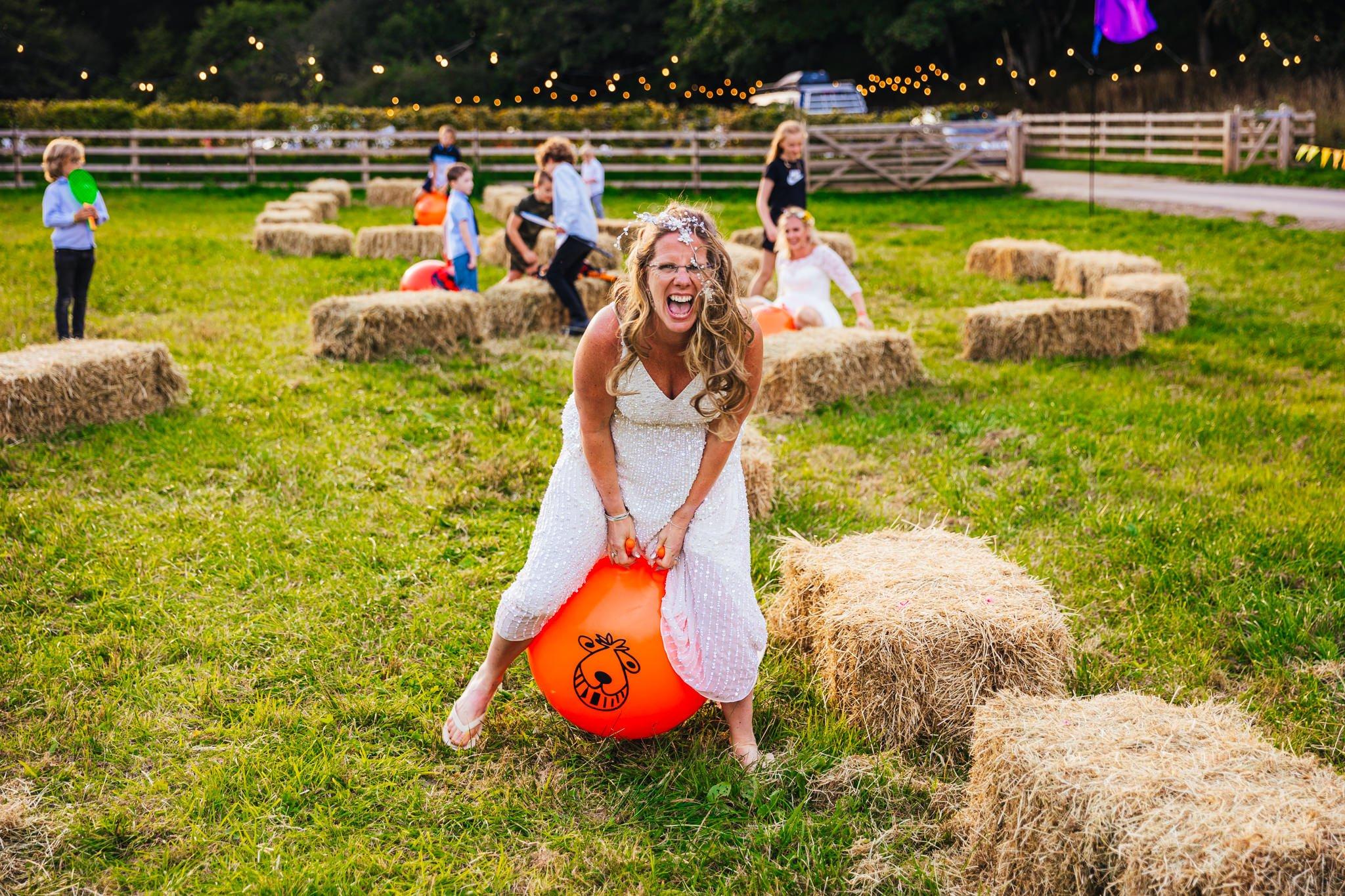 Nottingham wedding photography - Bride on orange space hopper